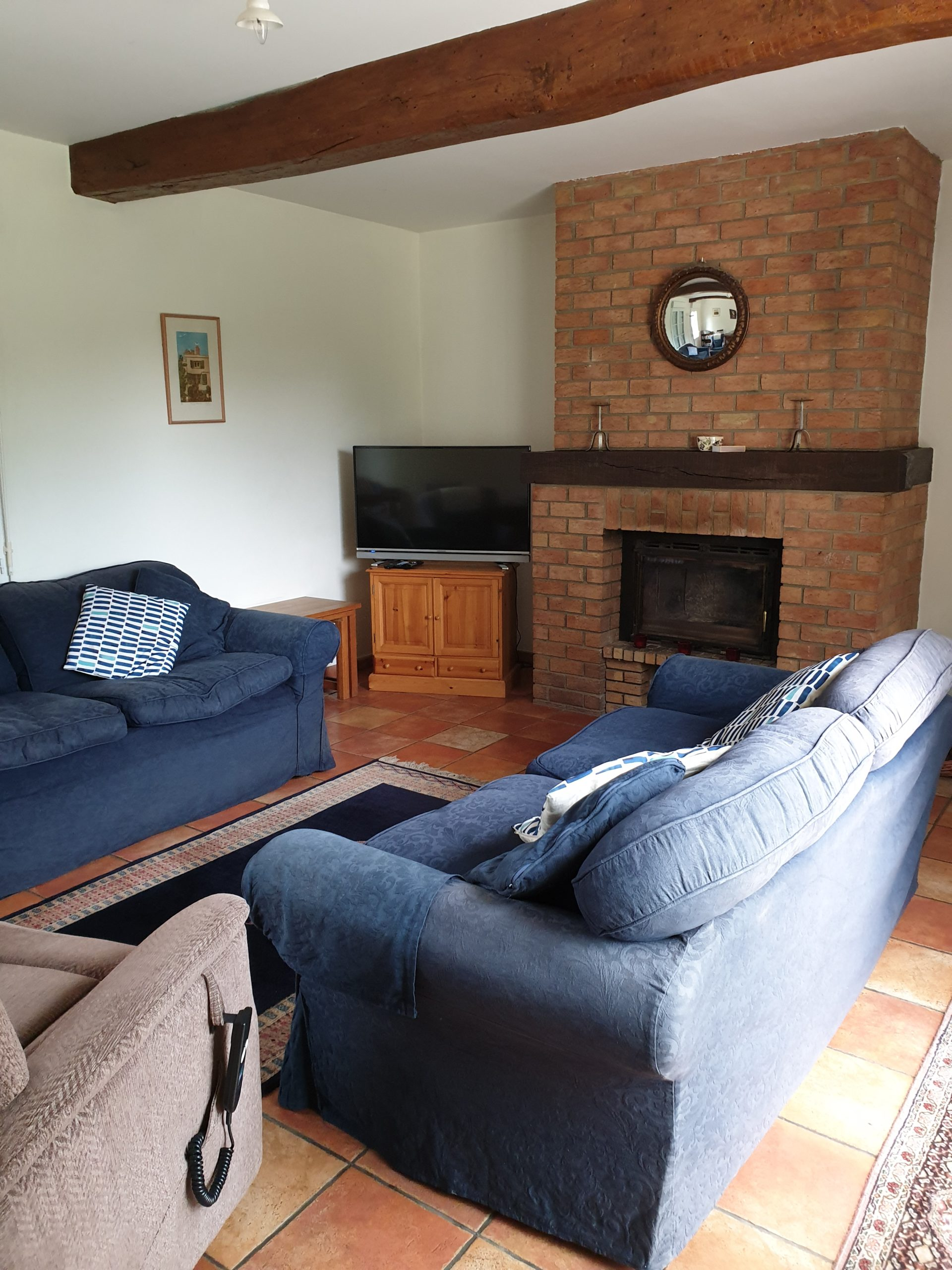Lounge with wood burner and smart TV with DVD player