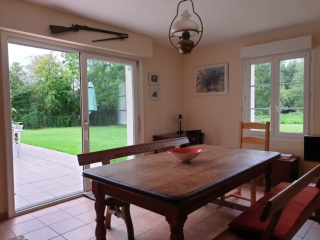 Dining Room with dual aspect windows and sliding patio door leading onto patio area and garden